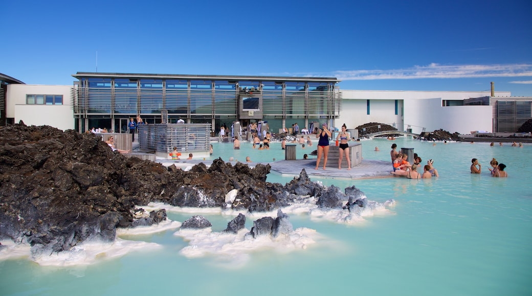 Blue Lagoon featuring a hot spring and a luxury hotel or resort as well as a large group of people