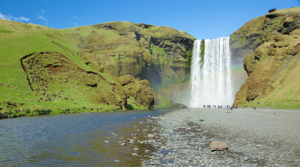 Skogafoss which includes a river or creek and a cascade