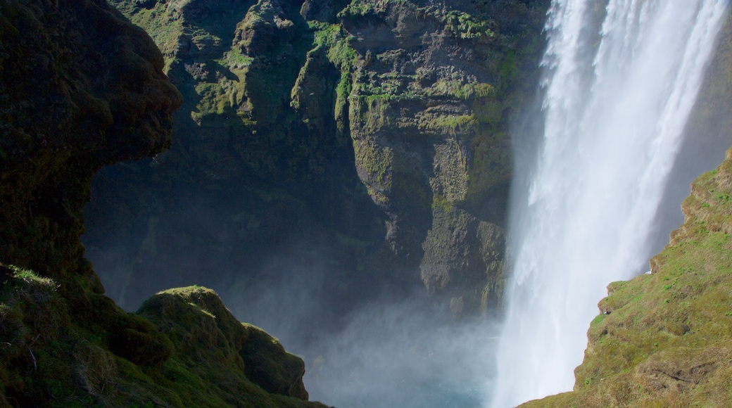 Skogafoss which includes a waterfall and a gorge or canyon