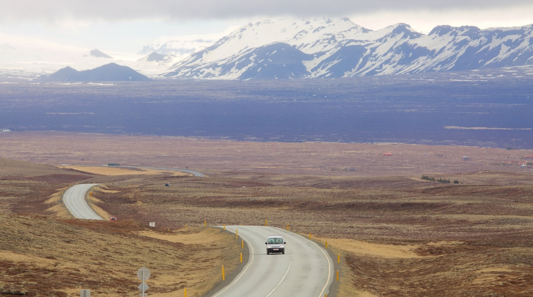 Thingvellir National Park which includes vehicle touring, tranquil scenes and mountains