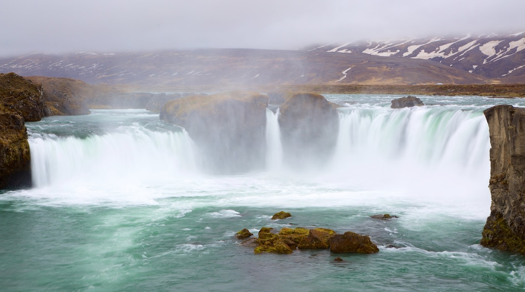 Godafoss which includes a waterfall and mist or fog