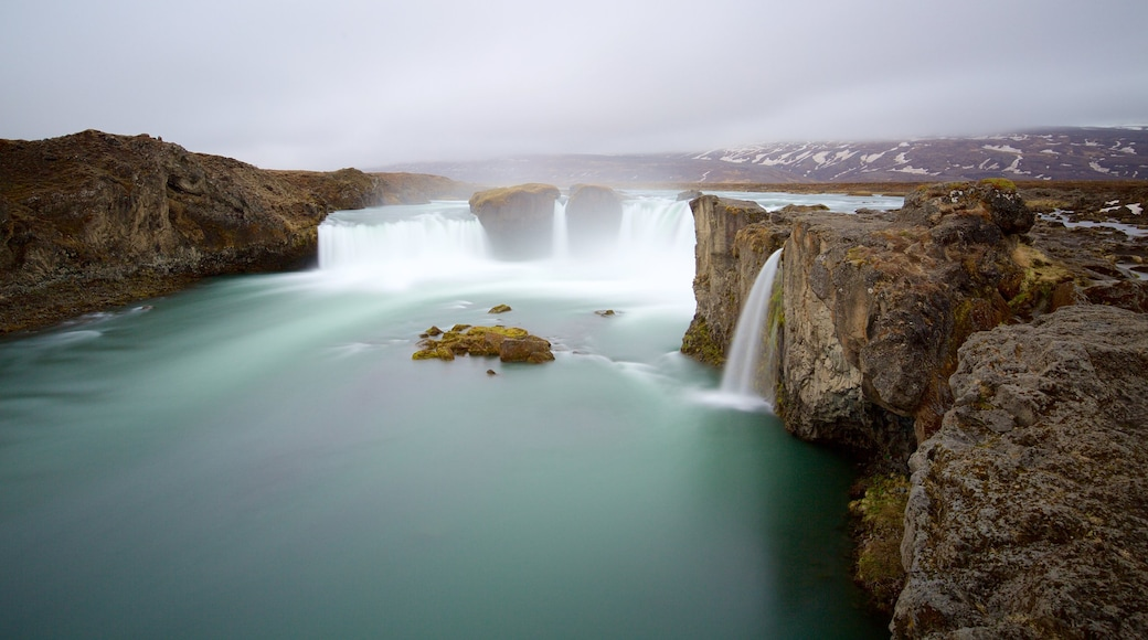 Godafoss showing mist or fog, a waterfall and a river or creek