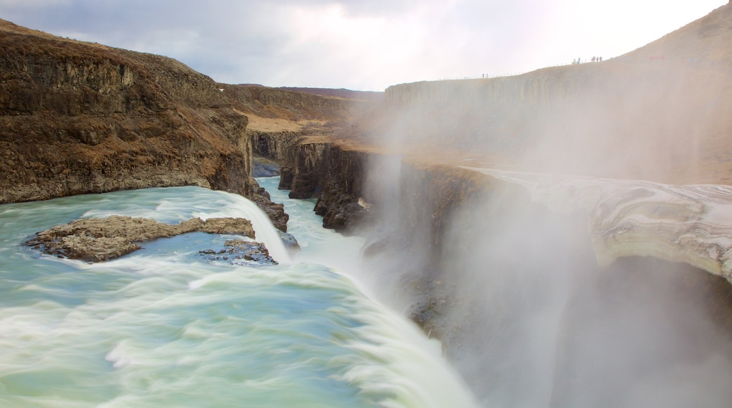 Gullfoss Waterfall featuring a gorge or canyon, mist or fog and a river or creek