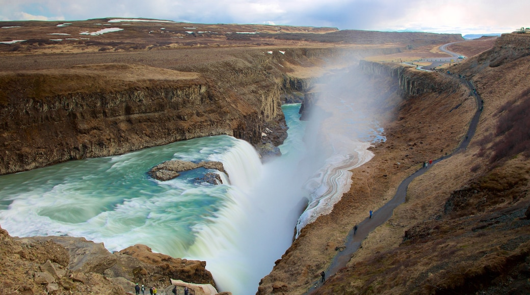 Gullfoss Waterfall featuring mist or fog, a gorge or canyon and a waterfall