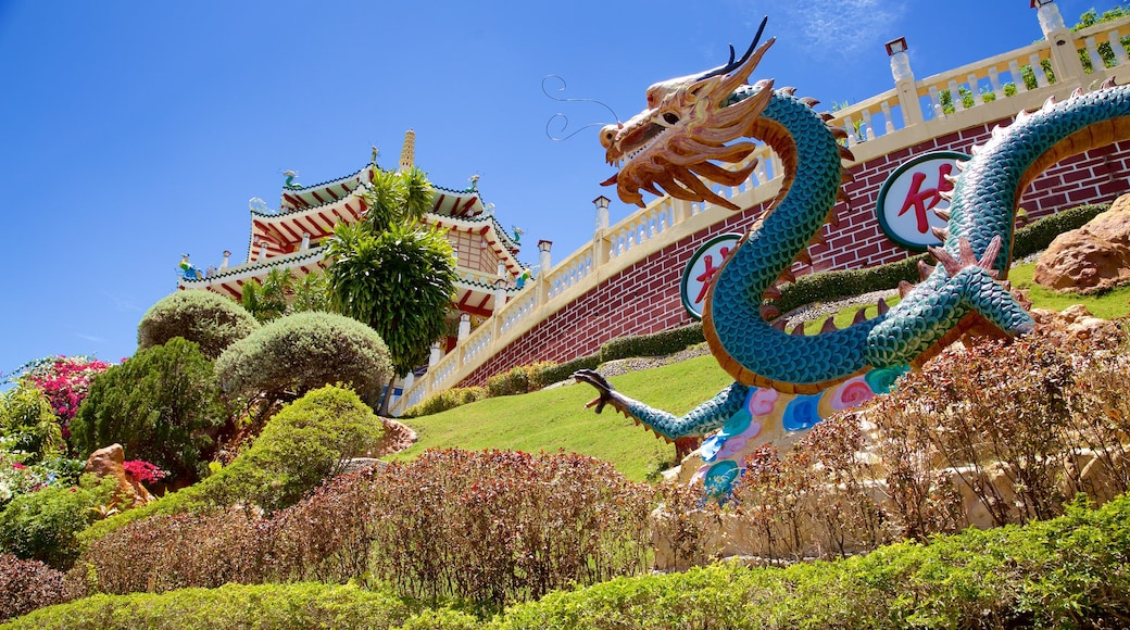 Philippines Taoist Temple showing a park and a statue or sculpture