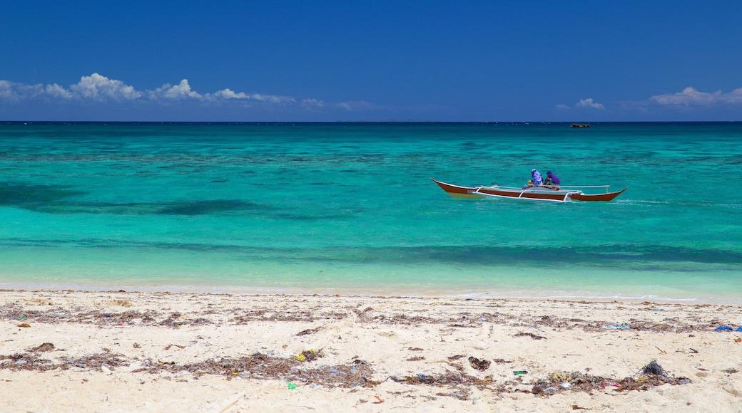 Guimbitayan Beach showing a sandy beach and general coastal views
