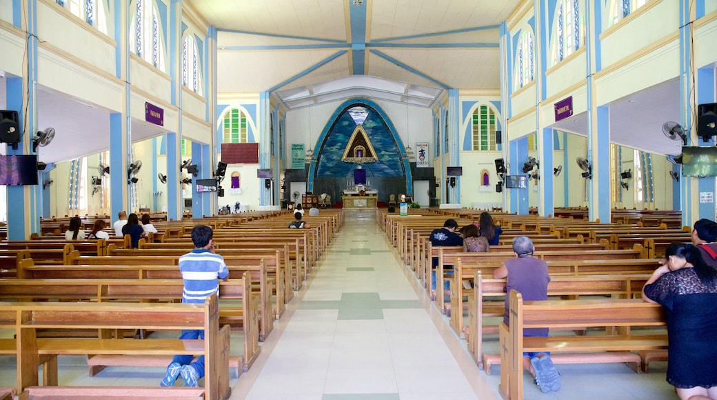 Our Lady of the Rule Church which includes religious elements, interior views and a church or cathedral