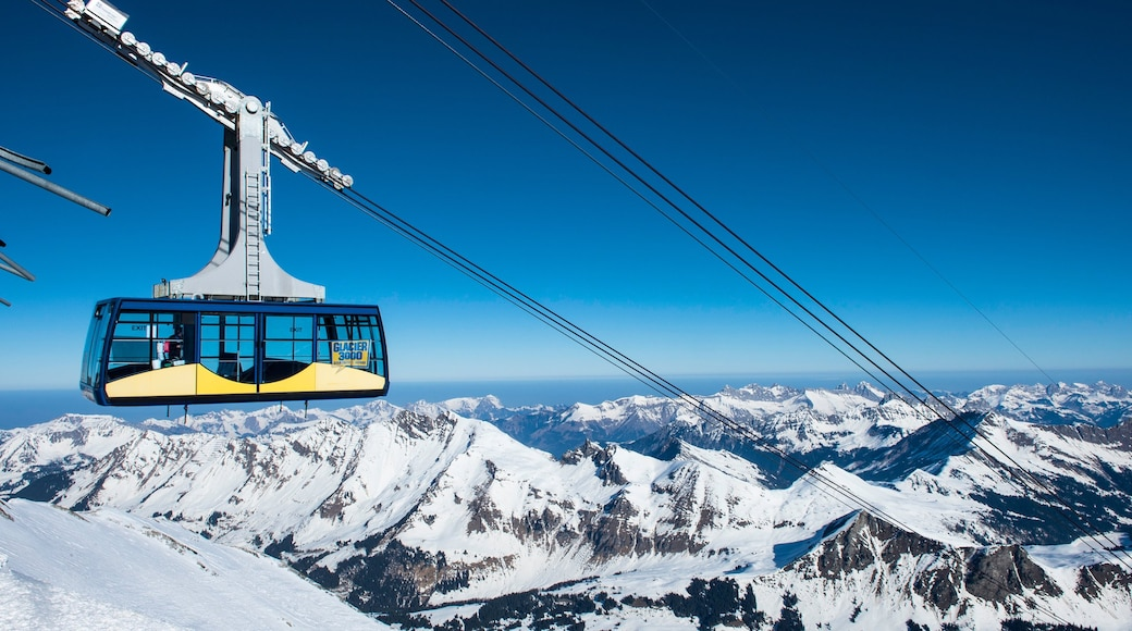 Les Diablerets Ski Resort showing a gondola, mountains and snow