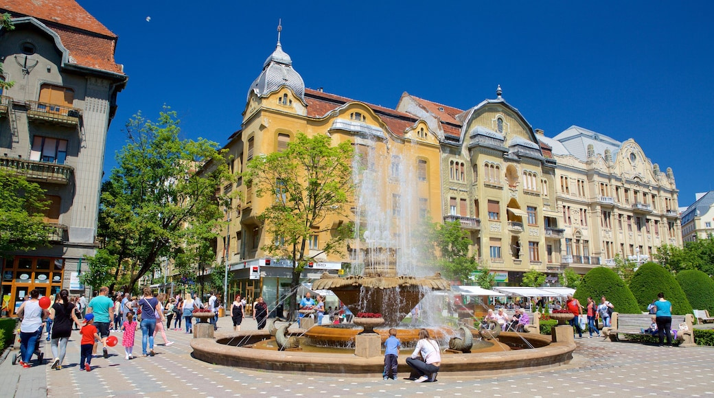 Piata Operei which includes heritage architecture and a fountain