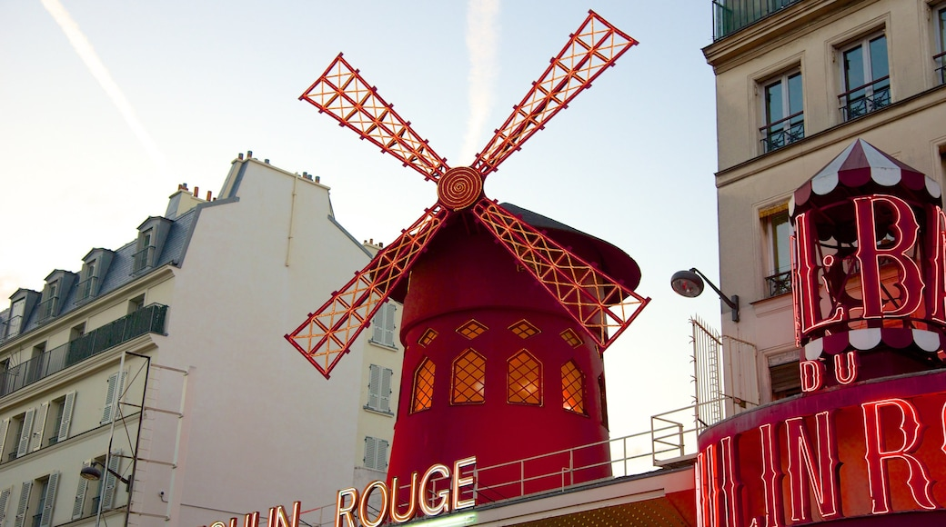 Pigalle featuring signage and a windmill