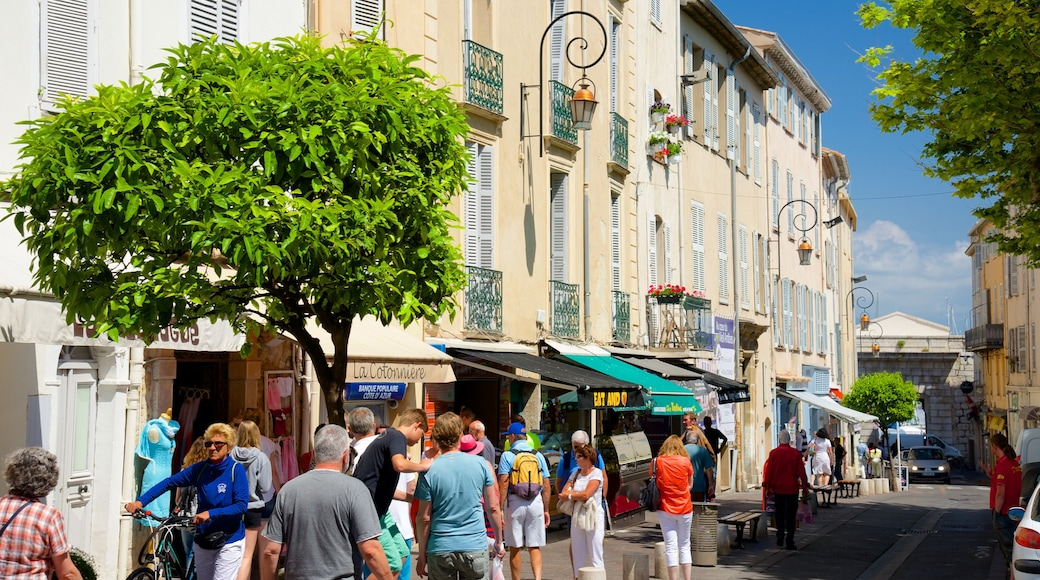 Antibes featuring a city and street scenes as well as a large group of people