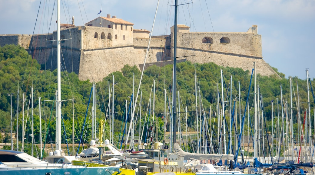 Antibes which includes a marina and a castle