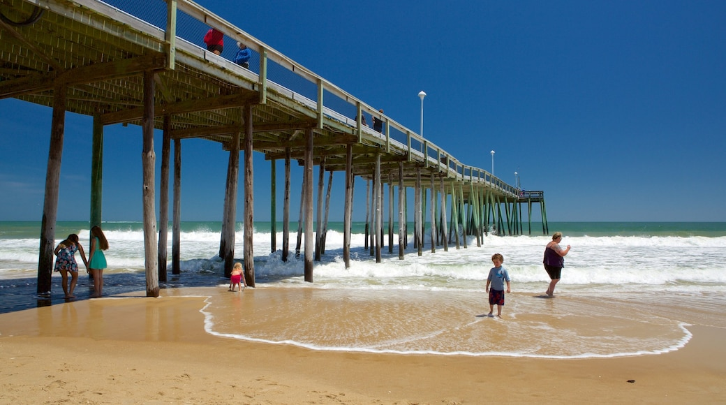 Ocean City Beach showing waves and a beach as well as a small group of people