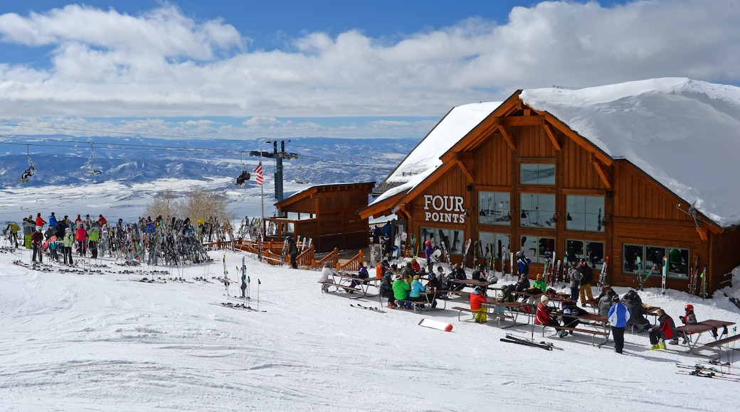 Steamboat Ski Resort which includes snow skiing and snow as well as a large group of people
