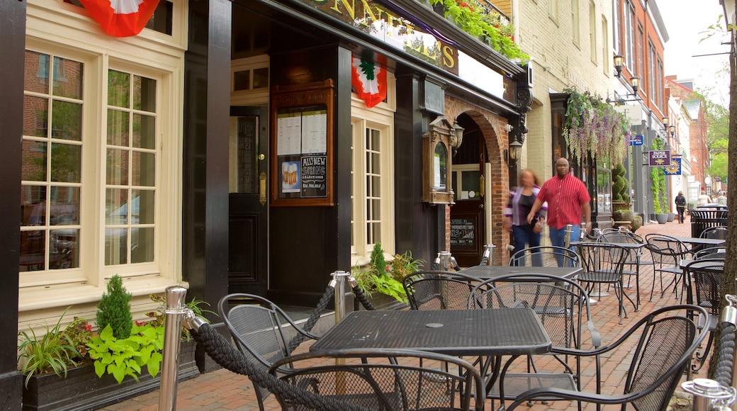 Alexandria ofreciendo café, escenas cotidianas y un pueblo