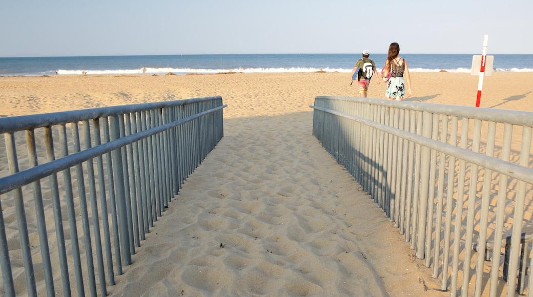 Sandbridge Beach featuring a sandy beach as well as a couple