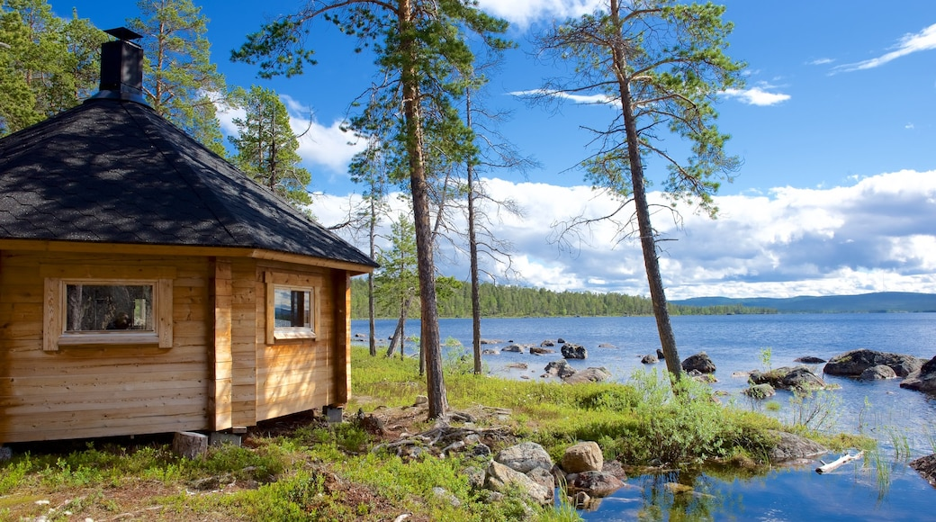 Inari featuring a lake or waterhole, tranquil scenes and a house
