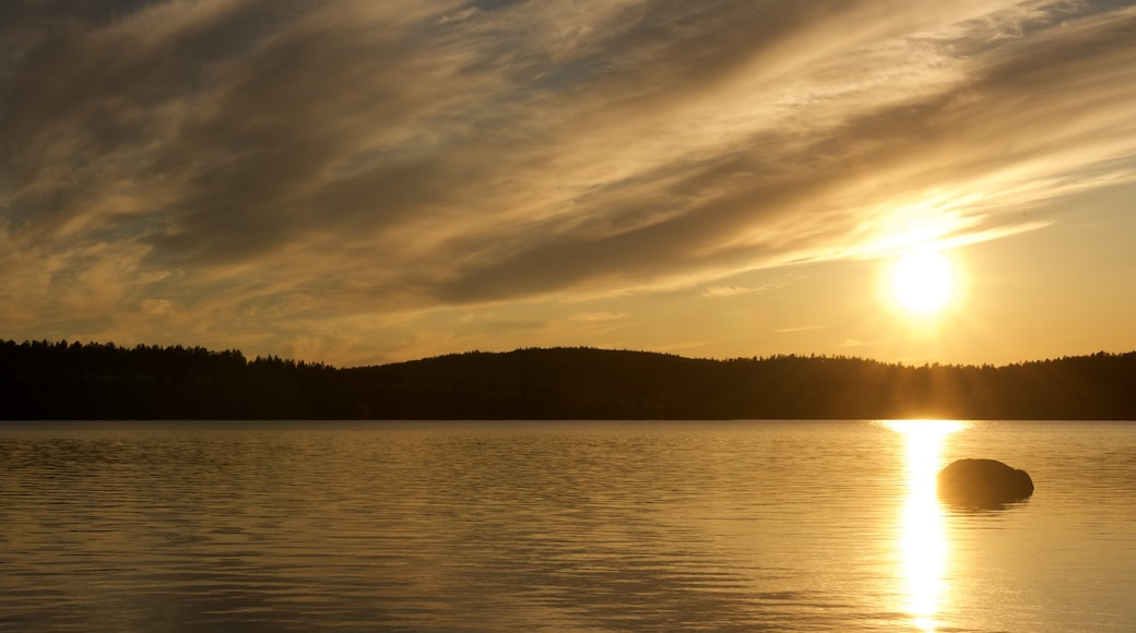 Inari which includes a sunset, a lake or waterhole and landscape views