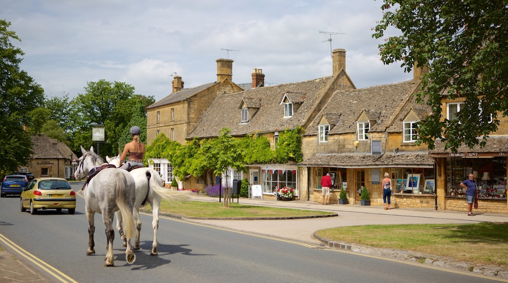 Broadway which includes horse riding, a small town or village and street scenes