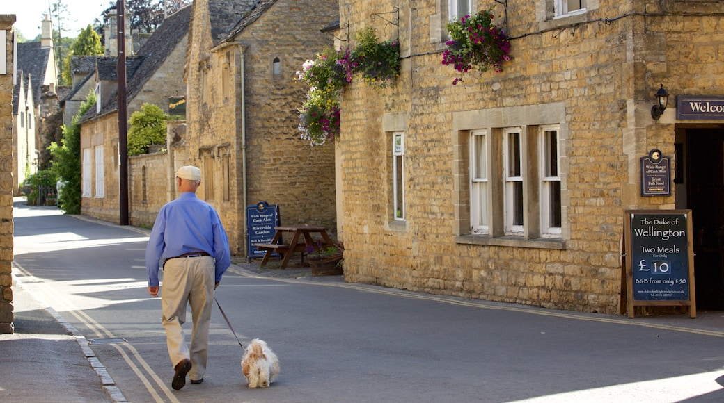 Bourton-on-Water which includes street scenes and a small town or village as well as an individual male
