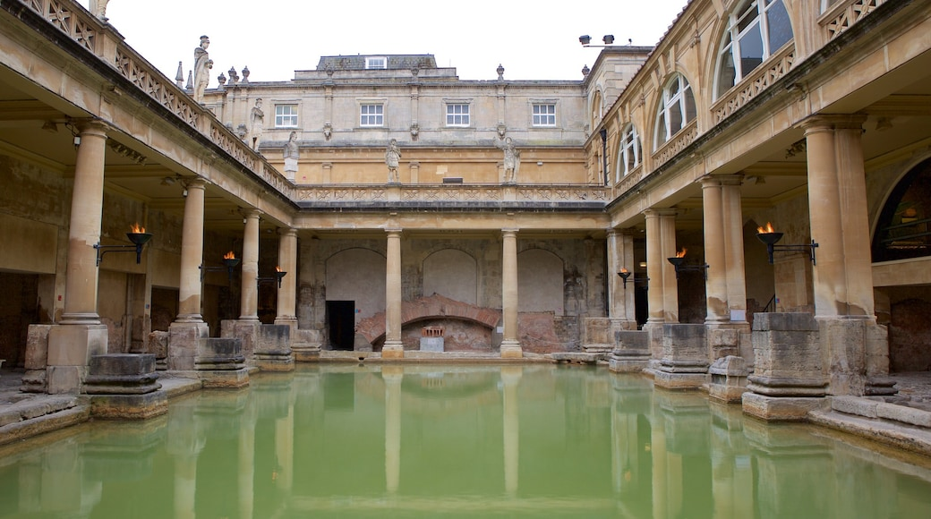 Roman Baths which includes heritage elements, a pool and heritage architecture