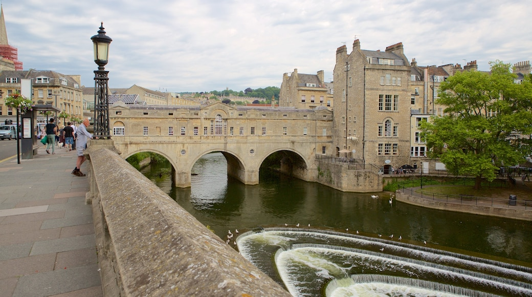 Pulteney Bridge featuring heritage architecture, street scenes and a river or creek
