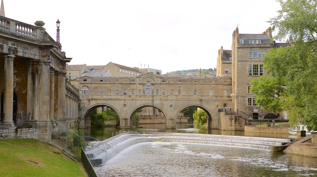 Pulteney Bridge showing heritage architecture, an administrative building and a city