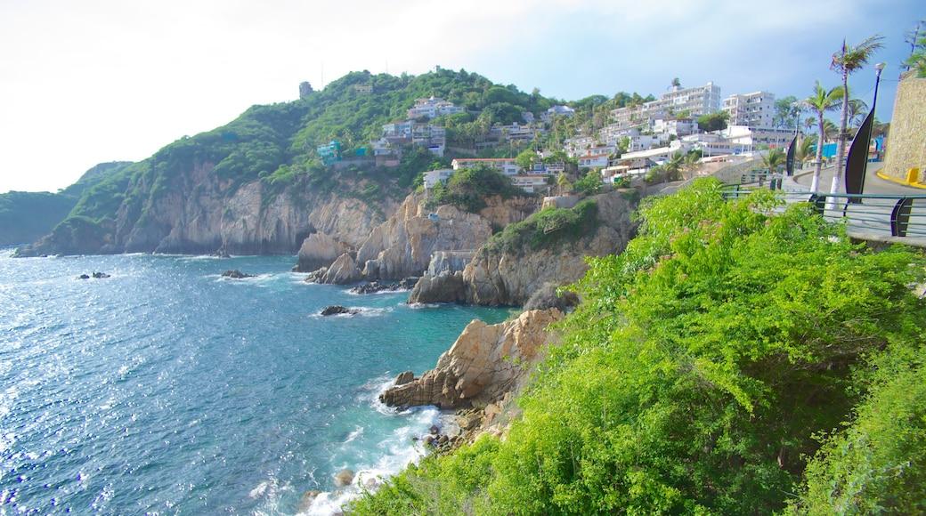 La Quebrada Cliffs featuring a gorge or canyon, rocky coastline and a coastal town