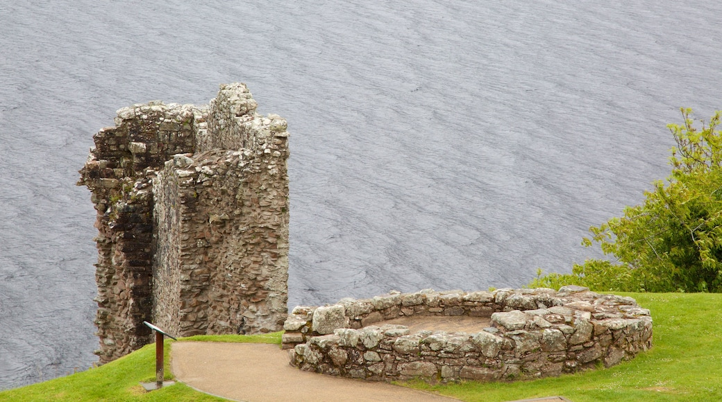 Urquhart Castle which includes a ruin and a lake or waterhole