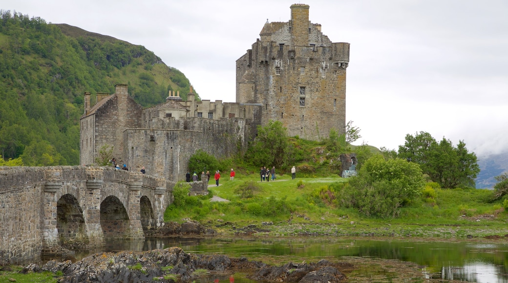 Eilean Donan Castle which includes a bridge, a river or creek and château or palace