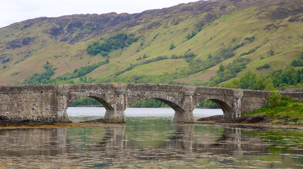 Eilean Donan Castle featuring a river or creek, a bridge and heritage elements