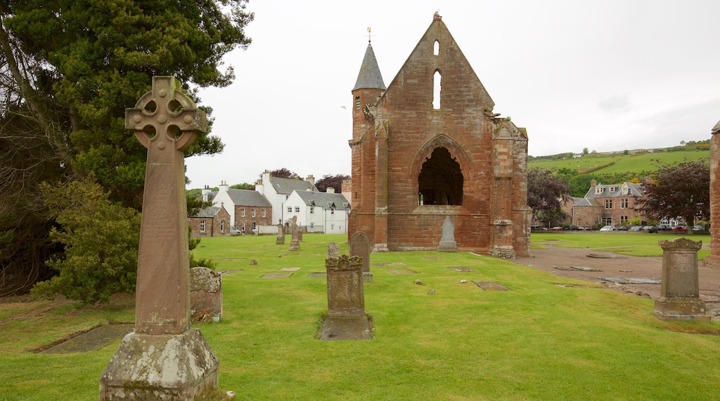 Fortrose Cathedral showing a cemetery, building ruins and a church or cathedral