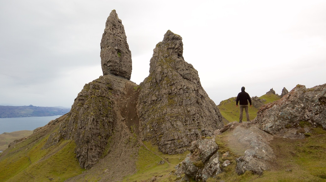 Old Man of Storr which includes tranquil scenes, hiking or walking and general coastal views