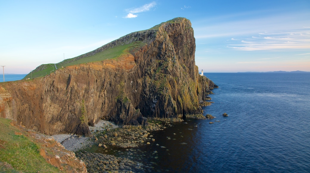 Isle of Skye featuring a lighthouse, mountains and rugged coastline
