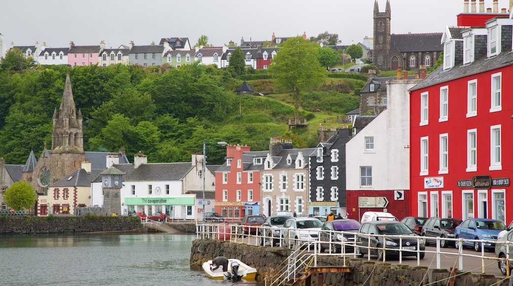 Isle of Mull showing a church or cathedral, a coastal town and a bay or harbour