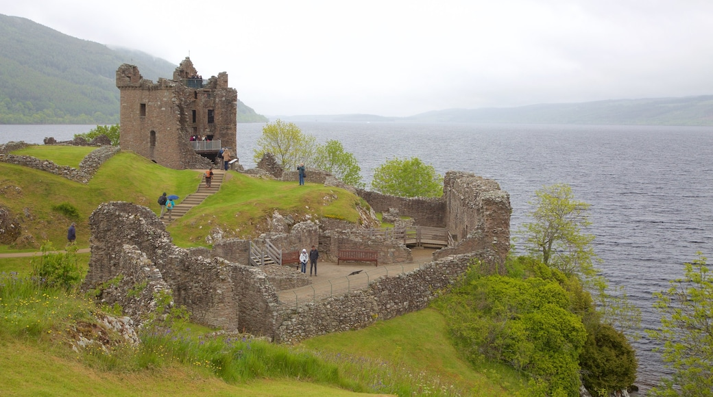 Urquhart Castle showing a lake or waterhole, château or palace and heritage elements