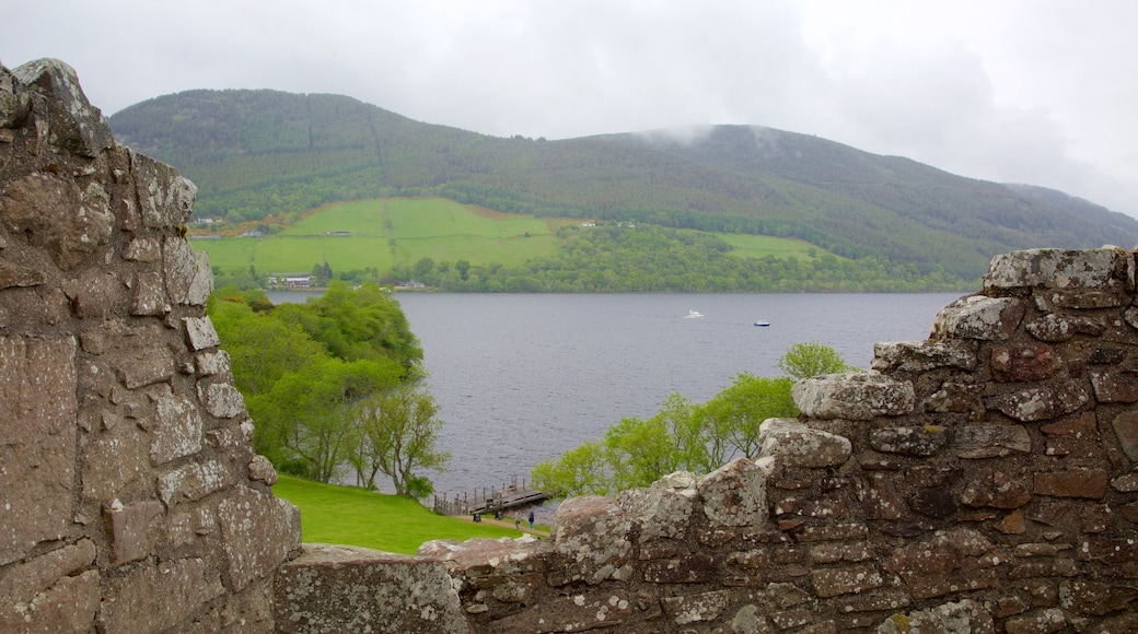 Urquhart Castle which includes a ruin, tranquil scenes and heritage elements
