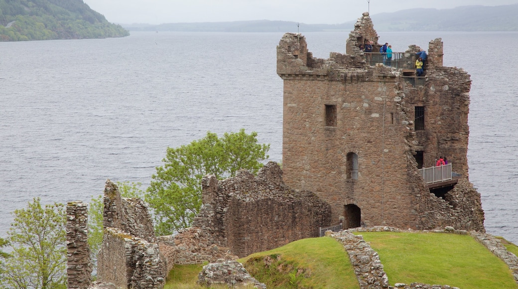Urquhart Castle featuring tranquil scenes, heritage elements and a lake or waterhole