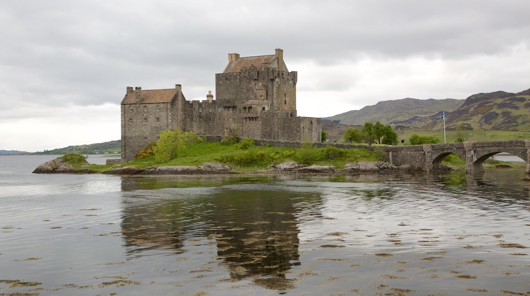 Eilean Donan Castle which includes a lake or waterhole, heritage elements and château or palace