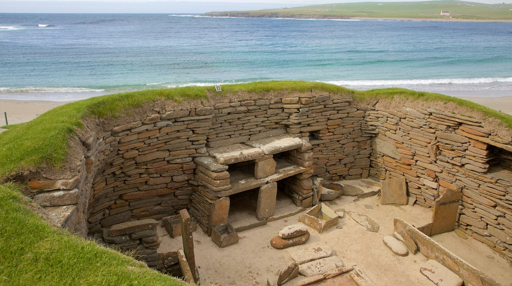 Skara Brae showing heritage elements, heritage architecture and a sandy beach
