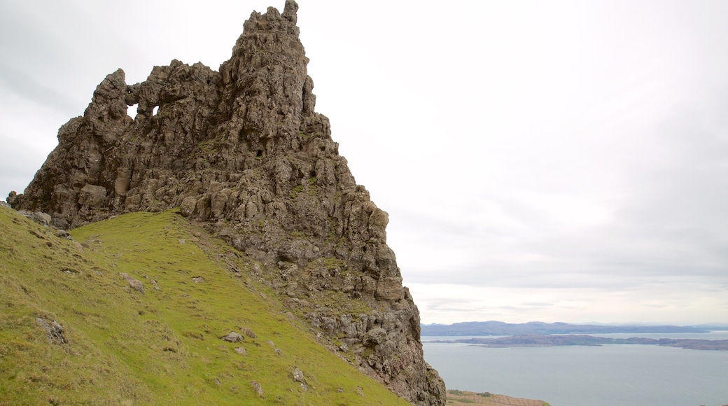 Old Man of Storr which includes tranquil scenes, a lake or waterhole and a monument
