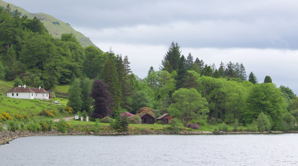 Fort William which includes tranquil scenes, a lake or waterhole and a house