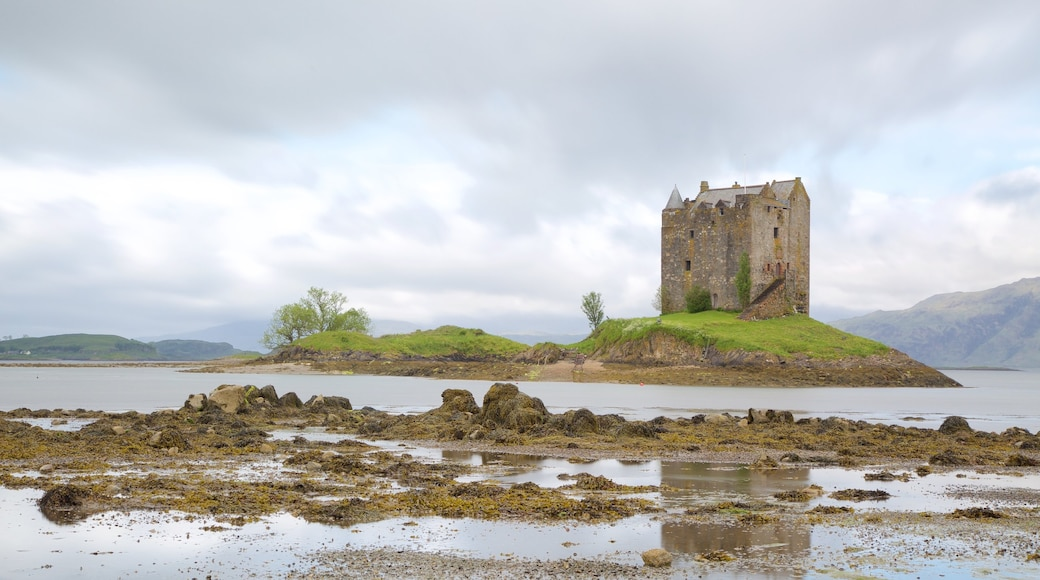 Castle Stalker showing a lake or waterhole, château or palace and heritage elements