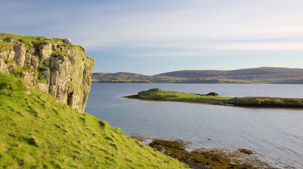 Isle of Skye which includes rocky coastline and tranquil scenes