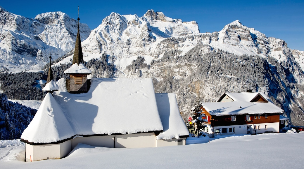 Engelberg featuring mountains, a church or cathedral and snow