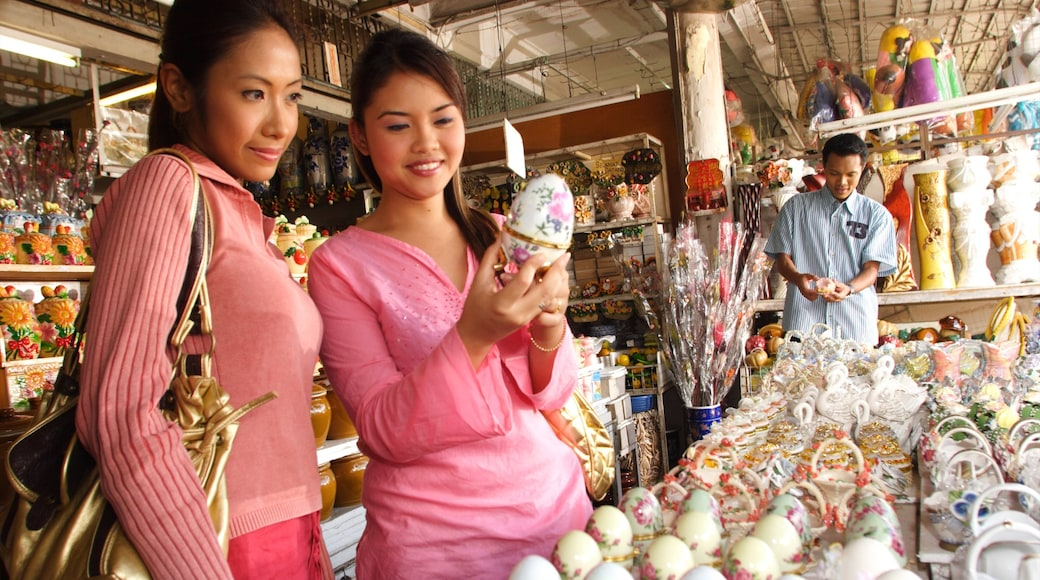 Johor which includes shopping and markets as well as a small group of people