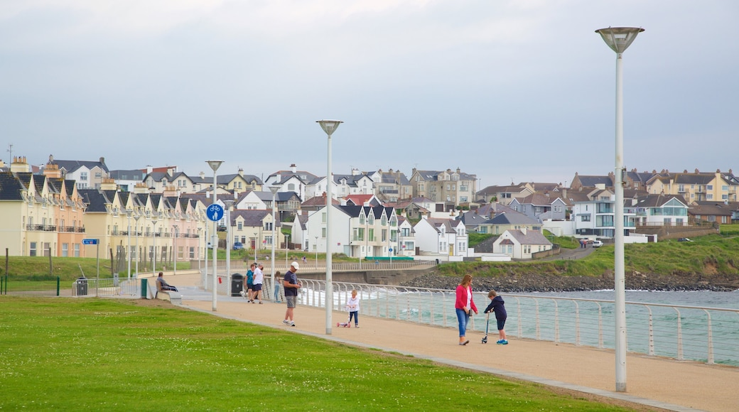 Portrush Beach showing a bay or harbour, general coastal views and a coastal town