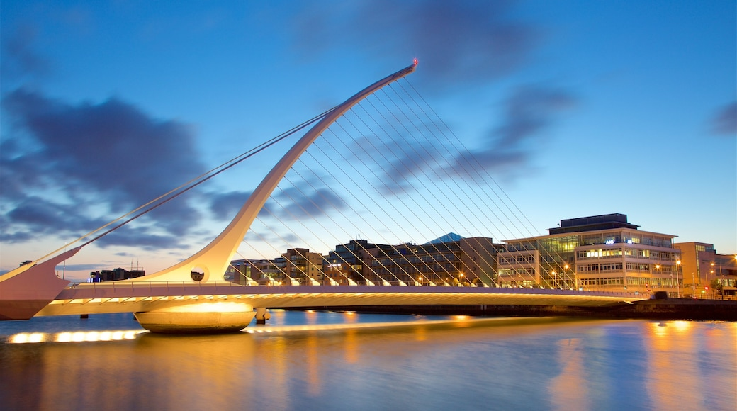 Dublin showing a bridge, modern architecture and a sunset