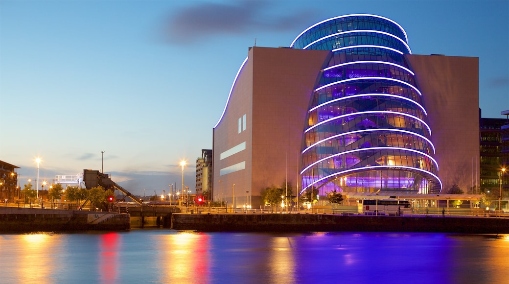 The Convention Centre Dublin featuring a city, a sunset and a river or creek