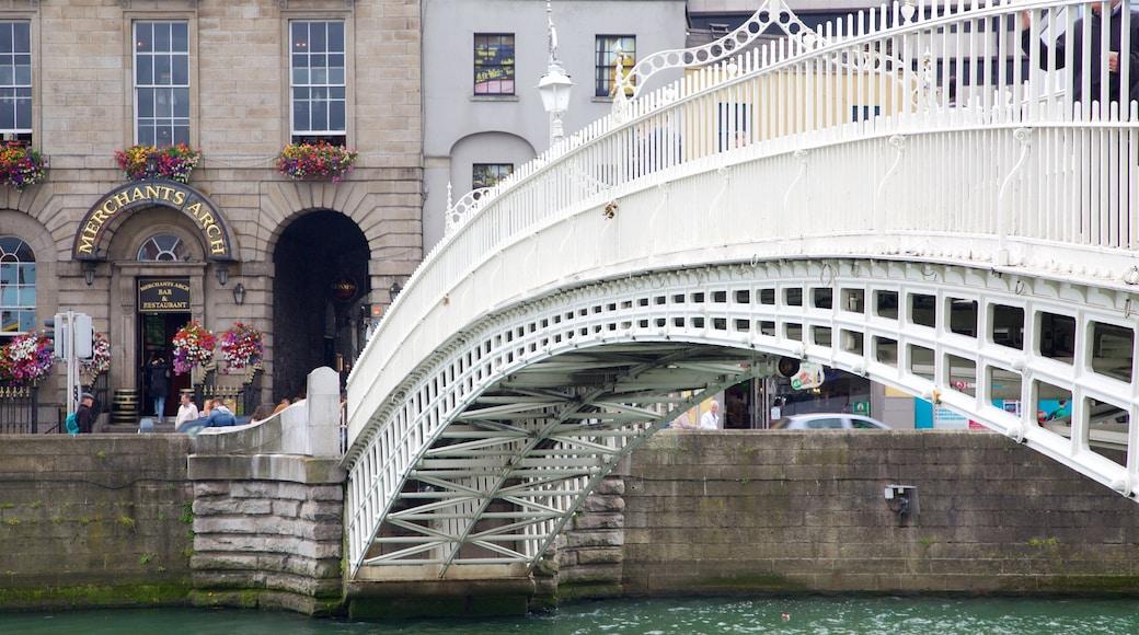 Ha\' Penny Bridge featuring a bridge and a river or creek